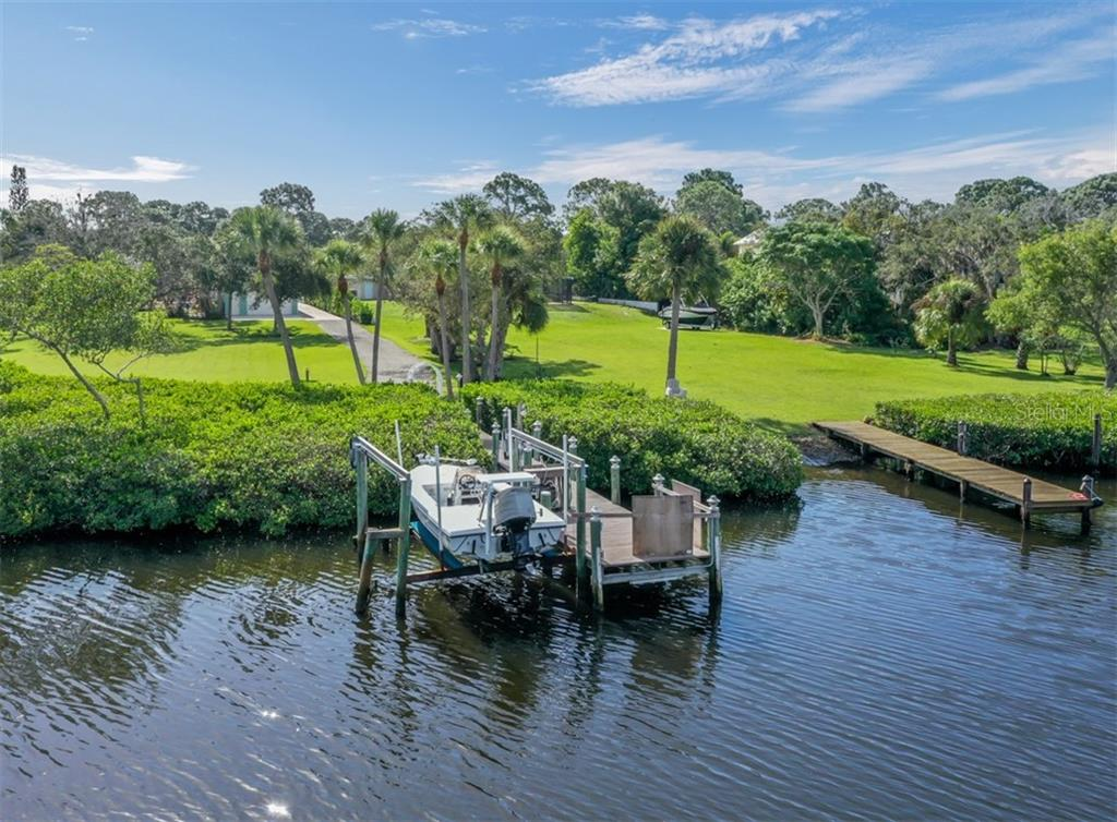 View from Forked Creek of Dock / Boat lift - Single Family Home for sale at 1395 Bayshore Dr, Englewood, FL 34223 - MLS Number is A4480508