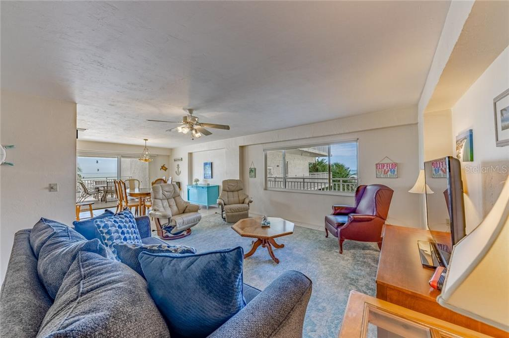 Walk in front door - Condo for sale at 5830 Midnight Pass Rd #303, Sarasota, FL 34242 - MLS Number is A4481917