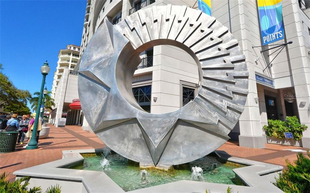 Nice sculpture and fountain in front of Plaza Five Points - Condo for sale at 50 Central Ave #16a, Sarasota, FL 34236 - MLS Number is A4482401