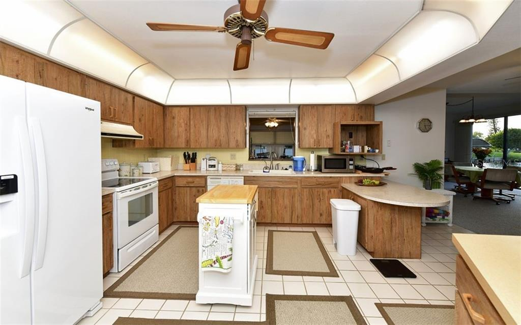 Kitchen with back to pantry. Window straight ahead above kitchen sink goes in to craft room/den/study or 5th bedroom - Single Family Home for sale at 9219 Bimini Dr, Bradenton, FL 34210 - MLS Number is A4483083
