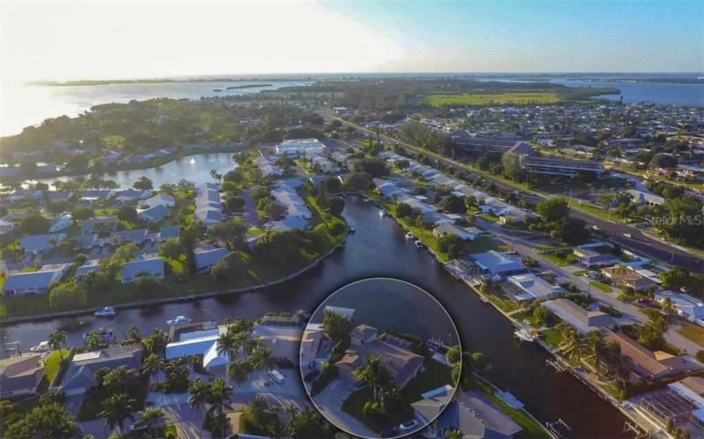 Wide canal in front of home allows separation from neighbors-water on the top right is Palma Sola Bay. Open water to the left brings you out to the Gulf - Single Family Home for sale at 9219 Bimini Dr, Bradenton, FL 34210 - MLS Number is A4483083