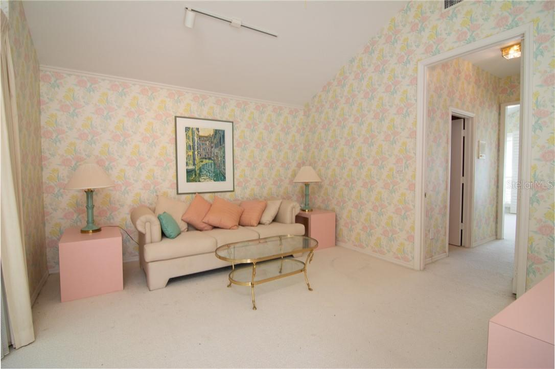 Second floor ensuite sitting room - Single Family Home for sale at Address Withheld, Sarasota, FL 34242 - MLS Number is A4483403