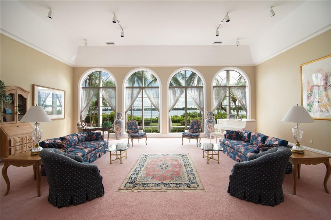 Main reception room. - Single Family Home for sale at Address Withheld, Sarasota, FL 34242 - MLS Number is A4483403