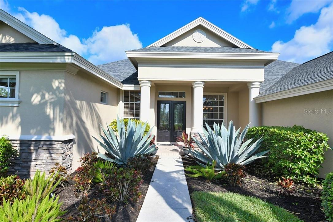 Double glass front doors welcome you home - Single Family Home for sale at 7832 Panther Ridge Trl, Bradenton, FL 34202 - MLS Number is A4483837
