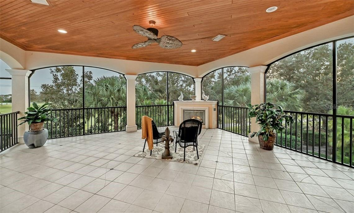 Upstairs terrace to enjoy those cool evenings in front of the fireplace & listen to all the wildlife talk to you. - Single Family Home for sale at 8263 Archers Ct, Sarasota, FL 34240 - MLS Number is A4483993