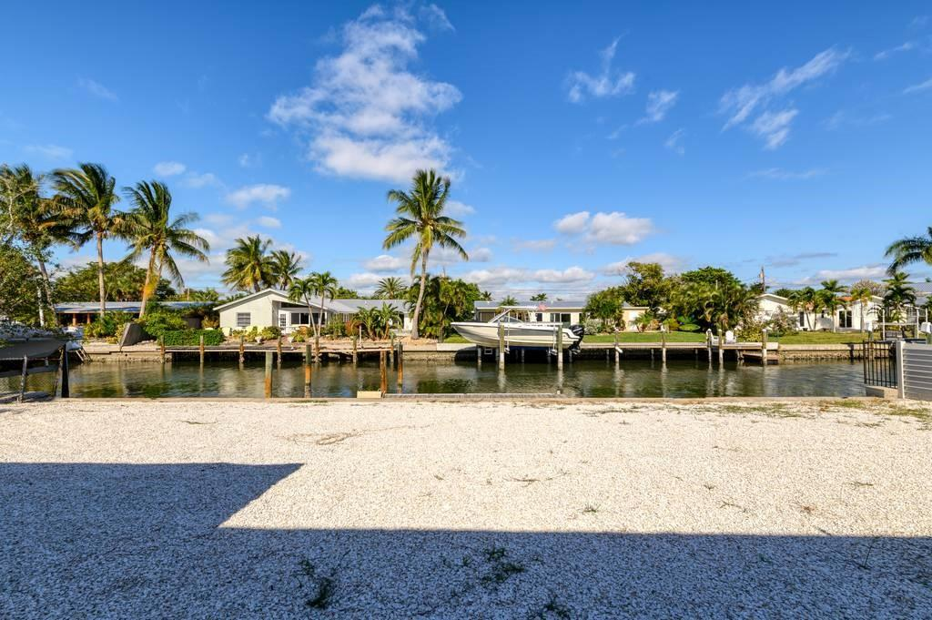 Single Family Home for sale at 512 68th St, Holmes Beach, FL 34217 - MLS Number is A4484565