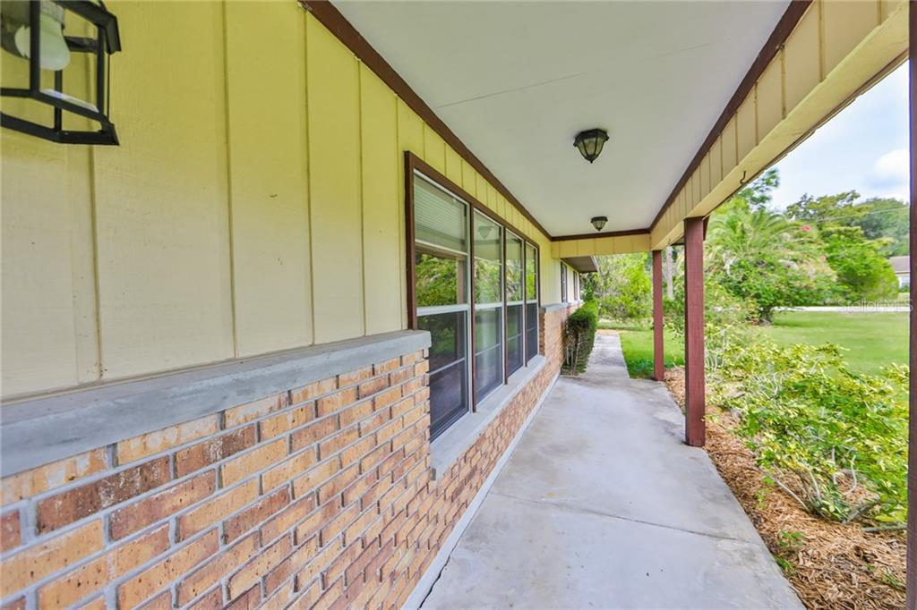 Open Front Porch - Single Family Home for sale at 6215 Braden Run, Bradenton, FL 34202 - MLS Number is A4484627