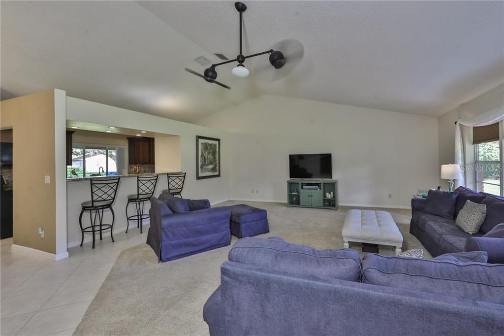 Great Room w/Breakfast Bar to Kitchen. - Single Family Home for sale at 6215 Braden Run, Bradenton, FL 34202 - MLS Number is A4484627
