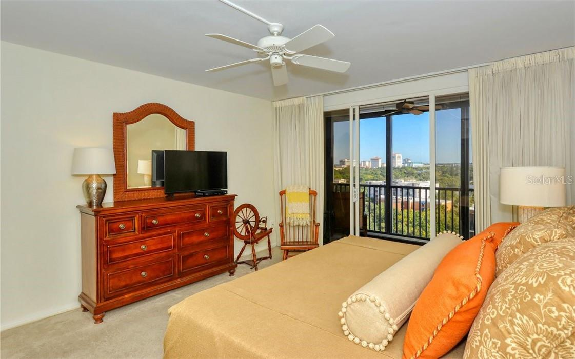 Primary bedroom with sweeping city views and access to the expansive balcony. - Condo for sale at 707 S Gulfstream Ave #1002, Sarasota, FL 34236 - MLS Number is A4484781