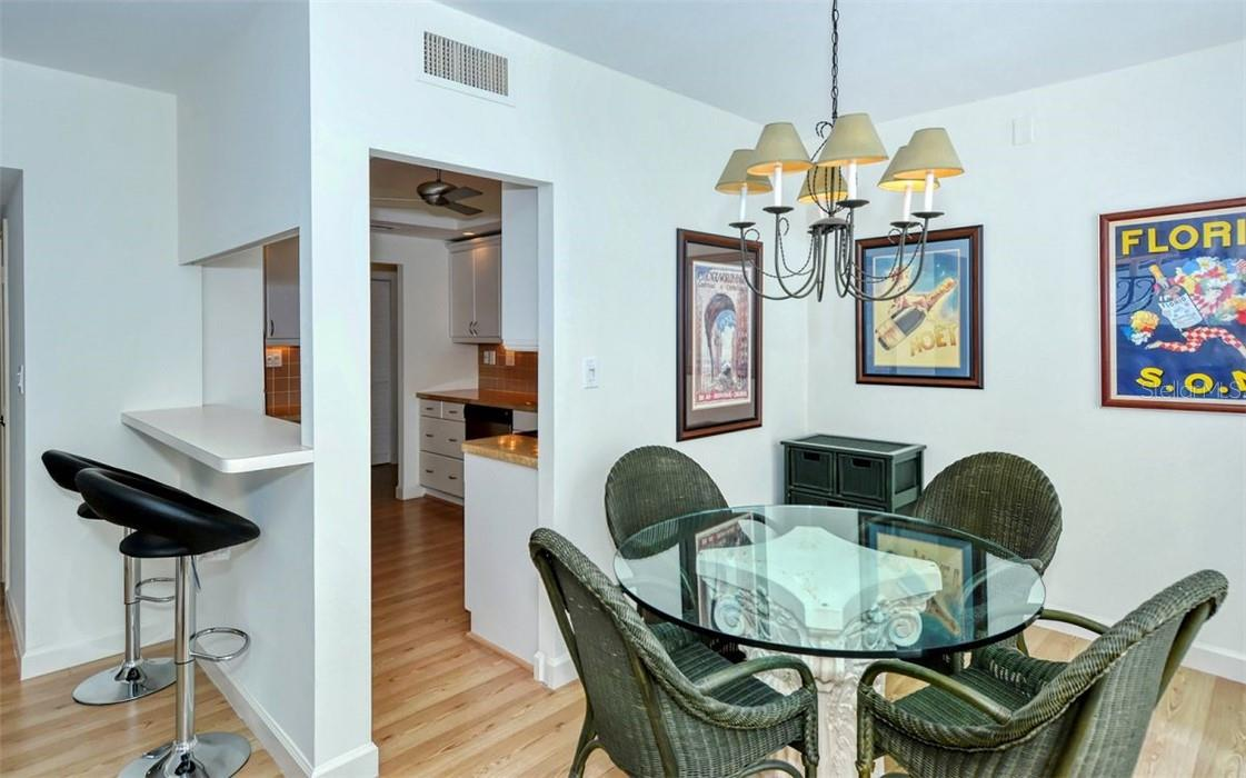 Dining room with pass through to the kitchen for extra seating and convenience. - Condo for sale at 707 S Gulfstream Ave #1002, Sarasota, FL 34236 - MLS Number is A4484781