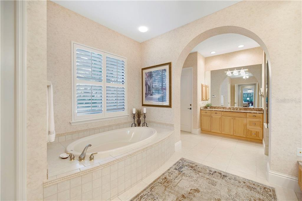 The door to the left of the vanity leads to the 1 car garage. - Single Family Home for sale at 13223 Palmers Creek Ter, Lakewood Ranch, FL 34202 - MLS Number is A4484826