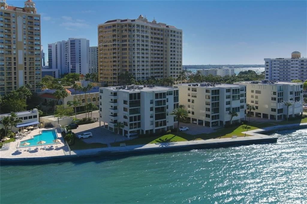 The Lawrence Point Community showing pool, clubhouse and Sarasota's downtown bayfront - Condo for sale at 101 Sunset Dr #103, Sarasota, FL 34236 - MLS Number is A4486187
