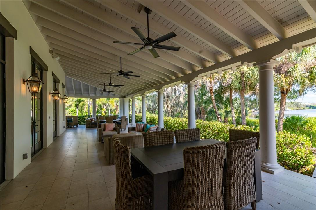 The large lanai at the River Lodge with expansive views of the Manatee River and Day Dock. - Single Family Home for sale at 11720 Rive Isle Run, Parrish, FL 34219 - MLS Number is A4486302