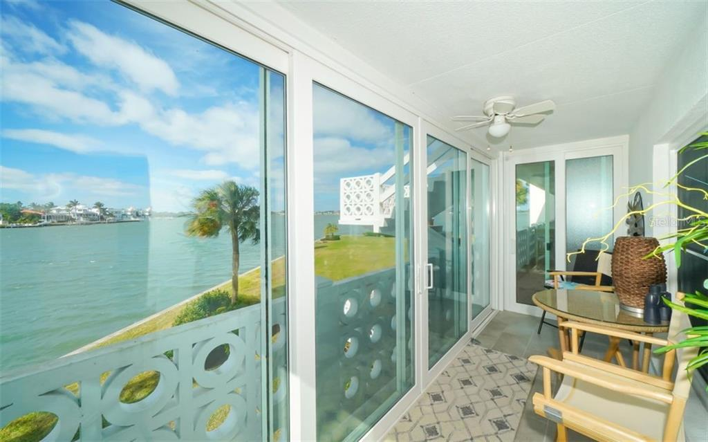 Sliding doors in porch provide a great view all the time! - Condo for sale at 761 John Ringling Blvd #28, Sarasota, FL 34236 - MLS Number is A4490945