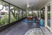 Backyard......notice home is elevated above flood with only one step from grade for entry - Single Family Home for sale at 6701 Avenue B, Sarasota, FL 34231 - MLS Number is A4171657