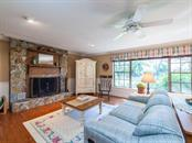 Living Room w/ large wood-burning fireplace. (two) - Single Family Home for sale at 7812 17th Ave W, Bradenton, FL 34209 - MLS Number is A4178350