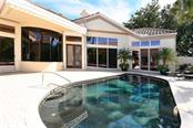 Courtyard pool, guest house and main house - Single Family Home for sale at 602 Weston Pointe Ct, Longboat Key, FL 34228 - MLS Number is A4178531