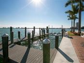 Dock with 30,000 lb boat lift - Single Family Home for sale at 100 S Warbler Ln, Sarasota, FL 34236 - MLS Number is A4184994