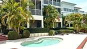 Spa pool outside your lanai - Condo for sale at 9209 Midnight Pass Rd #5, Sarasota, FL 34242 - MLS Number is A4185067