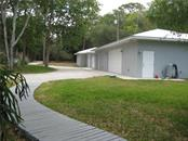 Newer Structures: Three Car Garage with Gulf Cart Parking, Work Space, Overhead Storage . Power and Water. Artist Studio or Apartment - One Bedroom, Bath, Kitchen/Dining Combo. Please see attachments for more specifications for these structures. - Single Family Home for sale at 4124 Windemere Pl, Sarasota, FL 34231 - MLS Number is A4186503