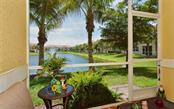 Covered lanai with lake views - Condo for sale at 81 Navigation Cir #103, Osprey, FL 34229 - MLS Number is A4188370