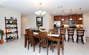 Dining area and Kitchen - Condo for sale at 81 Navigation Cir #103, Osprey, FL 34229 - MLS Number is A4188370
