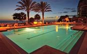 Twilight by the pool. - Single Family Home for sale at 1800 Benjamin Franklin Dr #b507, Sarasota, FL 34236 - MLS Number is A4188540