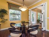 Wonderful breakfast nook  with folding doors welcoming in the bonus sunroom and into the screened outdoors. - Single Family Home for sale at 1884 Grove St, Sarasota, FL 34239 - MLS Number is A4189365