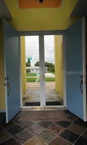 Front entrance into foyer with slate floor inside and on front porch. Your window into the friendly neighborhood! - Single Family Home for sale at 3319 Mayflower St, Sarasota, FL 34231 - MLS Number is A4189488