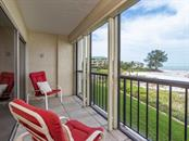 Screened balcony with beach and Gulf views - Condo for sale at 19 Whispering Sands Dr #205, Sarasota, FL 34242 - MLS Number is A4189914