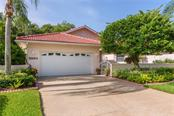 Single Family Home for sale at 5863 Lakeside Woods Cir, Sarasota, FL 34243 - MLS Number is A4193520