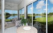 Long lake views from enclosed lanai. - Villa for sale at 604 Crossfield Cir #31, Venice, FL 34293 - MLS Number is A4193953