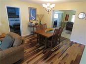 View of dining room.  Family room visible at rear to the right. - Single Family Home for sale at 829 Harbor Dr S, Venice, FL 34285 - MLS Number is A4198898