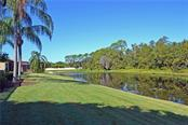 backyard and lake - Single Family Home for sale at 4616 Tuscana Dr, Sarasota, FL 34241 - MLS Number is A4200517