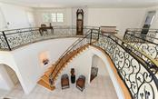 Curved, custom, hand crafted stairs and railing. - Single Family Home for sale at 1630 Harbor Sound Dr, Longboat Key, FL 34228 - MLS Number is A4204745