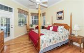 Large Master Bedroom with Sitting Area, Beautiful Hardwood Floors, notice Door to Pool and Lanai - Single Family Home for sale at 460 Otter Creek Dr, Venice, FL 34292 - MLS Number is A4205372
