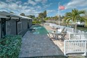 Sparkling swimming pool and spa, with pavers, looking to the Grand Canal. - Single Family Home for sale at 5633 Cape Leyte Dr, Sarasota, FL 34242 - MLS Number is A4207008