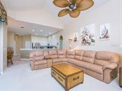 Family room - Single Family Home for sale at 1010 Oak Preserve Ln, Osprey, FL 34229 - MLS Number is A4207598