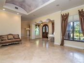 Living Room with decorative barrel ceiling - Single Family Home for sale at 7715 Donald Ross Rd W, Sarasota, FL 34240 - MLS Number is A4208499