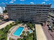 Take a splash in the huge community pool - Condo for sale at 6140 Midnight Pass Rd #608, Sarasota, FL 34242 - MLS Number is A4209897