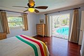 2nd bedroom with pool view - Single Family Home for sale at 600 Wild Turkey Ln, Sarasota, FL 34236 - MLS Number is A4210585