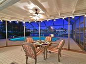 Pool area evening dining lights - Single Family Home for sale at 3807 Royal Palm Dr, Bradenton, FL 34210 - MLS Number is A4402342