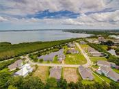 Aerial view of neighborhood and Palma Sola Bay. - Single Family Home for sale at 8139 37th Avenue Cir W, Bradenton, FL 34209 - MLS Number is A4404272