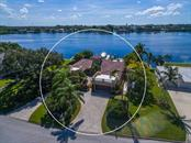 Front aerial elevation; wide open water views! - Single Family Home for sale at 301 Bayview Pkwy, Nokomis, FL 34275 - MLS Number is A4405265