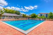 Heated Olympic sized pool at the clubhouse, get your laps in before your tennis game or cool off afterward. - Condo for sale at 1660 Starling Dr #202, Sarasota, FL 34231 - MLS Number is A4405877