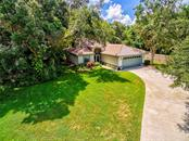 Single Family Home for sale at 4464 Ascot Cir S, Sarasota, FL 34235 - MLS Number is A4407459