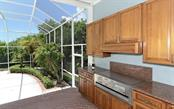 Outdoor Kitchen - Single Family Home for sale at 1427 Cedar Bay Ln, Sarasota, FL 34231 - MLS Number is A4408881