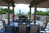 2nd Outdoor Grill & Dining Area - Condo for sale at 1211 Gulf Of Mexico Dr #705, Longboat Key, FL 34228 - MLS Number is A4410234