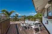Deck, table & chairs - Single Family Home for sale at 6661 Gulf Of Mexico Dr, Longboat Key, FL 34228 - MLS Number is A4410988