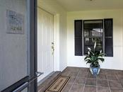 Screened in patio entrance - Villa for sale at 7467 Carnoustie Dr #5d, Sarasota, FL 34238 - MLS Number is A4412518